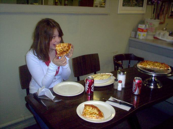 Eating Avril's pizza